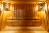 wooden bench and wall in sauna steam baked room , interior