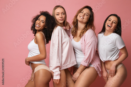 Fototapeta Group of women with different body types in underwear on pink background obraz na płótnie