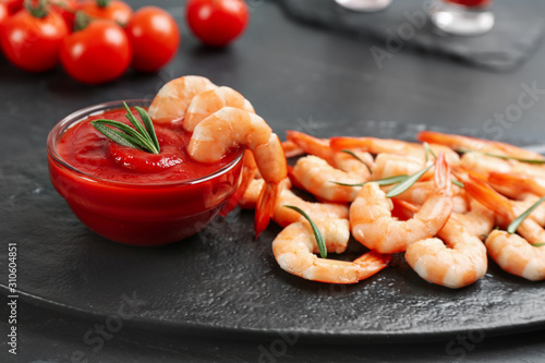 Delicious shrimp cocktail with tomato sauce served on black table Wallpaper Mural