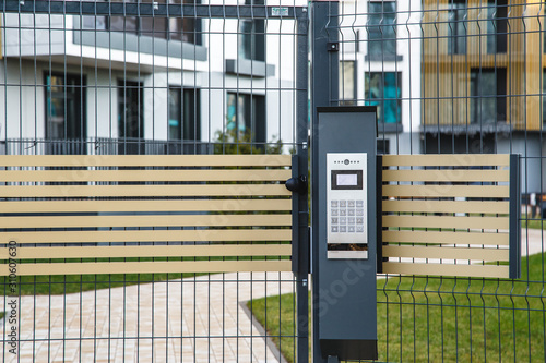 Photo Video intercom on the gate at the entrance to the residential area