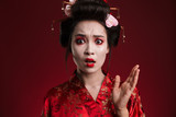 Image of shocked geisha woman in japanese kimono gesturing hand
