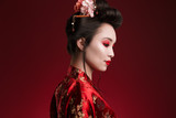 Image of charming geisha woman in japanese kimono looking downward