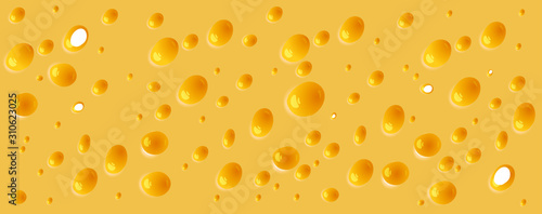 Background of thin slice of hard yellow cheese with holes