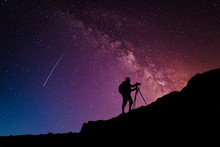 Camera Man Silhouette On The Mountain Over Milky Way Night Stars Sky