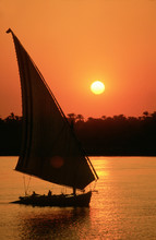 Felucca Sailing At Sunset On The River Nile