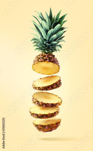 Flying fresh ripe pineapple cut into slices Wallpaper Mural