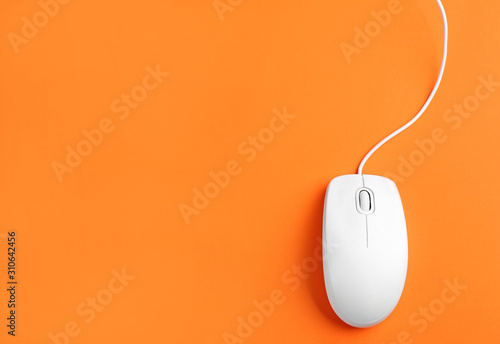 Fotografie, Obraz Modern wired optical mouse on orange background, top view