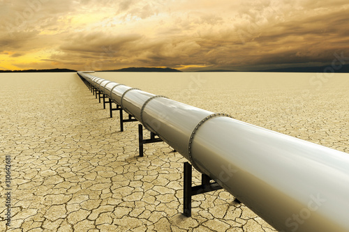 Fototapeta 3D rendering of a pipeline over a dry land on the desert obraz