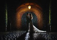 Wedding - Beautiful Bride And Groom Under The Rain