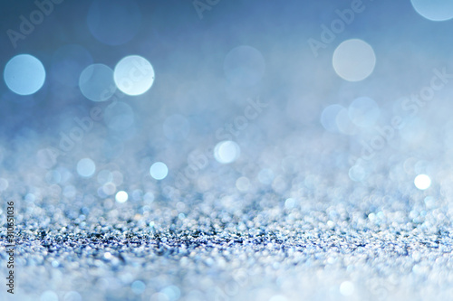 Fototapety, obrazy: blue Sparkling Lights Festive background with texture. Abstract Christmas twinkled bright bokeh defocused and Falling stars. Winter Card or invitation