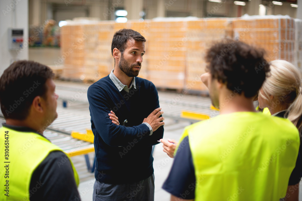 Fototapeta Warehouse meeting, managers and workers