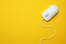 Wired Computer Mouse On Yellow...
