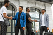 four handsome young african men on the background of the building