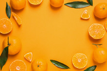 Frame Made Of Fresh Ripe Tangerines And Space For Text On Orange Background, Flat Lay. Citrus Fruit