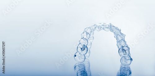 Photo Invisible orthodontics cosmetic brackets, tooth aligners, plastic braces