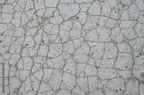 Fotomural Old road background - surface of grey cracked asphalt texture