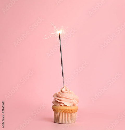Birthday cupcake with sparkler on pink background Canvas Print