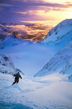 Skier Moving Down Slope