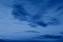 Dark Classic Royal Blue Clouds In Night Evening Sky. Natural Eco Nature Background Texture With Copyspace. Toned With Trend Popular Color Of 2020 Year Blue.
