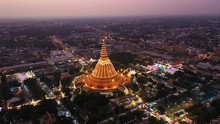 Aerial View Point Of Interest Of Big Golden Pagoda Decorated With Lighting During Sunset Of Nakhon Phatom Province, Thailand