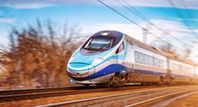 Modern High Speed Aerodynamic Streamlined Electric Train Passing By.