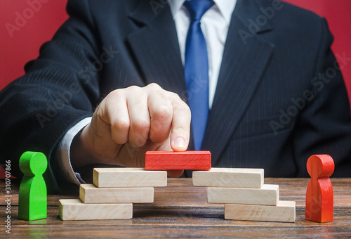 Photo The man provides the conditions for negotiations and conflict resolution between opponents