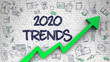 Brick Wall with 2020 Trends Inscription and Green Arrow. Business Concept. 2020 Trends - Development Concept. Inscription on White Brickwall with Doodle Icons Around.