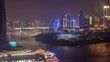 Chongqing night city river cityscape with bridges aerial China timelapse pan up