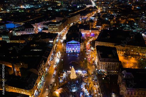 Fototapeta Opening of Christmas tree near Opera House in Lviv, Ukraine. View from drone obraz na płótnie