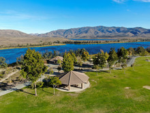 Aerial View Of Little Park In Front Of Otay Lake City Reservoir With Blue Sky And Mountain On The Background, Chula Vista, California. USA