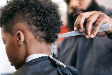 Barber: Stylist Combs Out Curl...