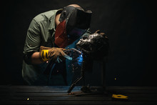 Artist Welding Metal Sculpture...