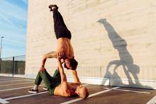 Young Athletic Men Doing Balan...