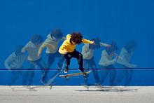Ethnic Man Doing Skateboard Jump