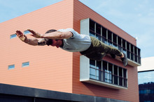 Athletic Man Doing Parkour Exe...