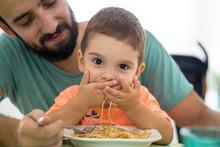 Boy Eating Spaghetti With His Father