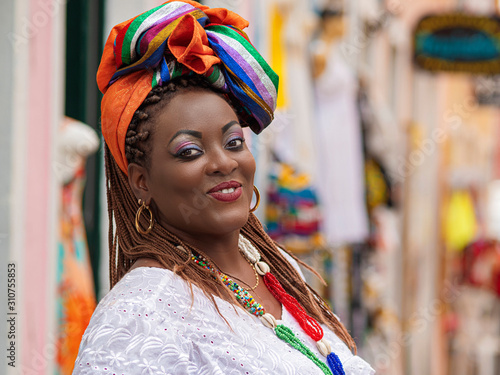 Leinwand Poster Happy Brazilian Woman of African Descent Dressed in Traditional Baiana Costumes