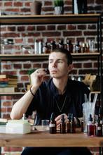 Professional Man Preparing Perfume