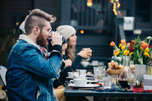 Man Taking A Drink With Friends