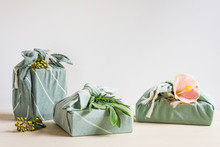 Three Gifts Wrapped In Cotton Material