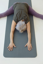 Aged Woman Doing Stretching