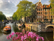 canvas print picture - Tour Boat Along a Canal in Amsterdam