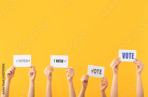 Fotografie, Obraz  Hands of voting people with paper sheets on color background