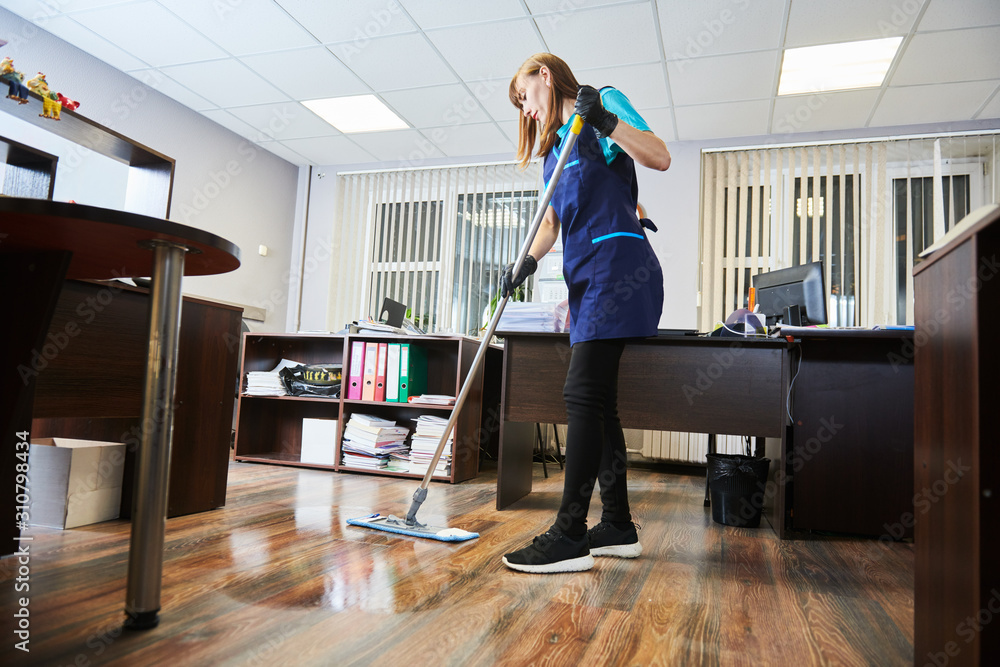 Fototapeta cleaning service. wiping office floor with mop