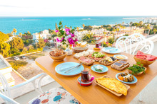 Breakfast On The Beach At Hotel Or Resort By The Sea In Summer Season. Holiday And Vacation Breakfast Image.Traditional Turkish Or Greek Breakfast At Bodrum Town Beach In Turkey Or Greece