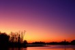 canvas print picture - Red evening sunset on the lake