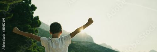 Young boy enjoying life looking at sunrise Canvas Print