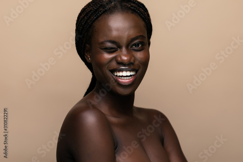 Portrait of a young beautiful african woman isolated over white background