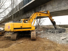 An Excavator Running A Reinfor...