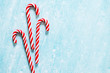 canvas print picture - Christmas candy canes on blue background